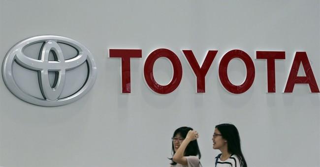 Toyota chalks up record profit, vehicle sales