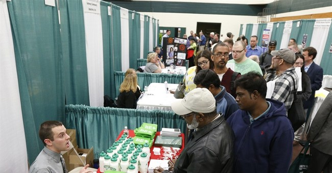 Applications for US unemployment aid fall to 319K