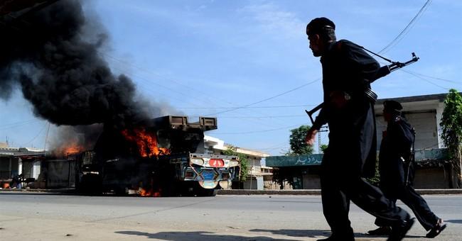 Attacks kill 10 Pakistani troops; missile tested