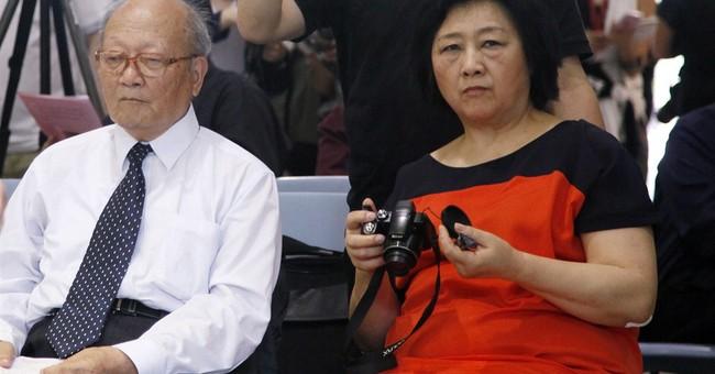 China detains veteran journalist for state secrets