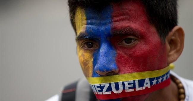 Cop killed in clashes after raids in Venezuela
