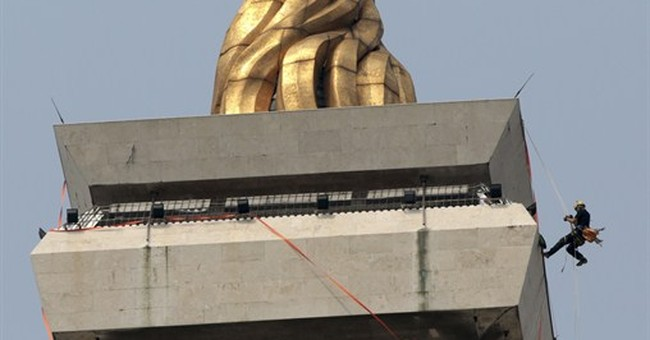 AP PHOTOS: Indonesia cleans national monument