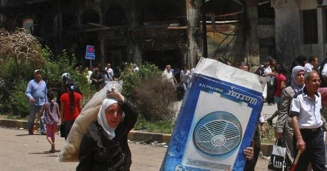 Thousands of Syrians enter Homs after rebels leave