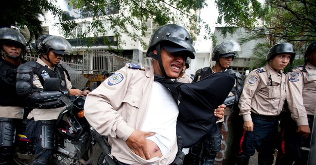 Venezuela sends 11 students to trial, frees others