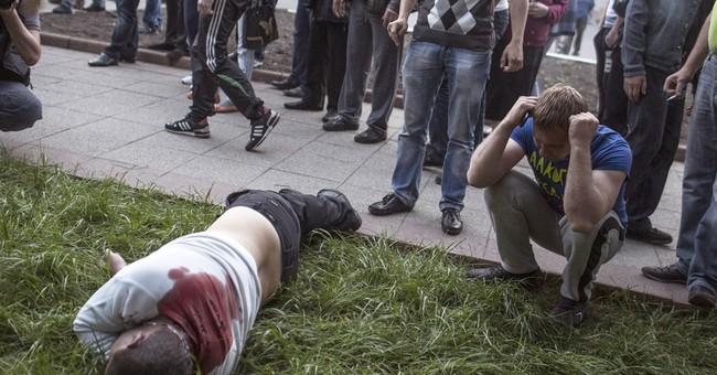 Armed men in eastern Ukraine open fire on crowd