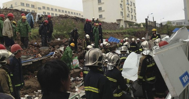 Wall collapses in eastern China, killing 18 people