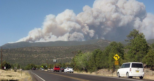 Air tankers, helicopters attack New Mexico fire