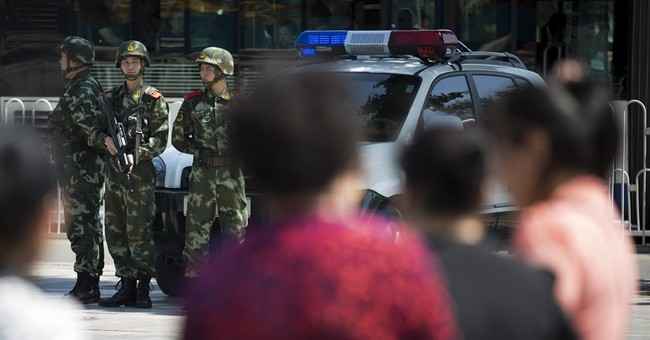 Beijing adds armed police patrols after attacks