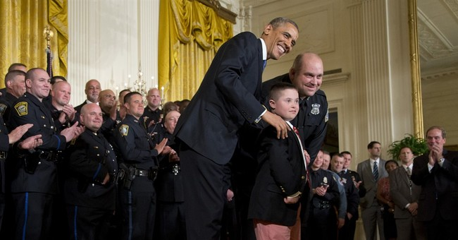 Honoring cops, Obama says US owes police a debt