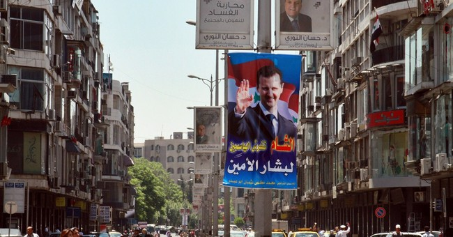 Battles rage in eastern Syria, activists say
