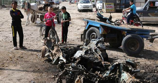 Car bomb blasts kill 34 as Iraqis await vote count