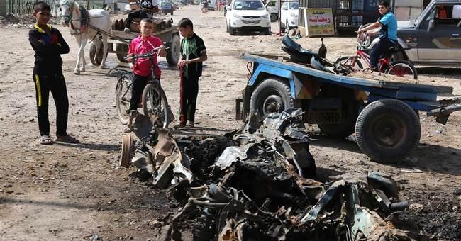 Car bomb blasts kill 34 as Iraqis await vote count