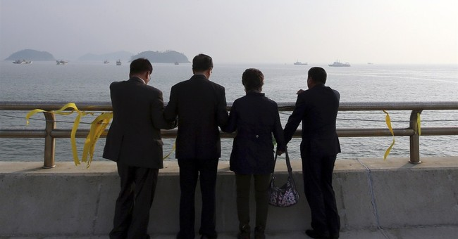 Body found in South Korean ferry as weather eases