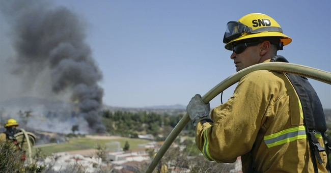 AP PHOTOS:  Wildfire burns homes in Southern Calif