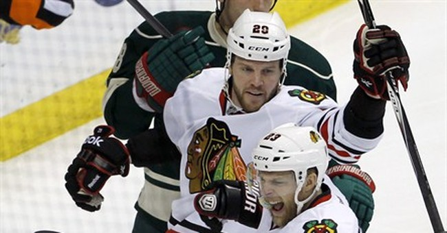 Kane, Blackhawks top Wild 2-1 in OT to advance