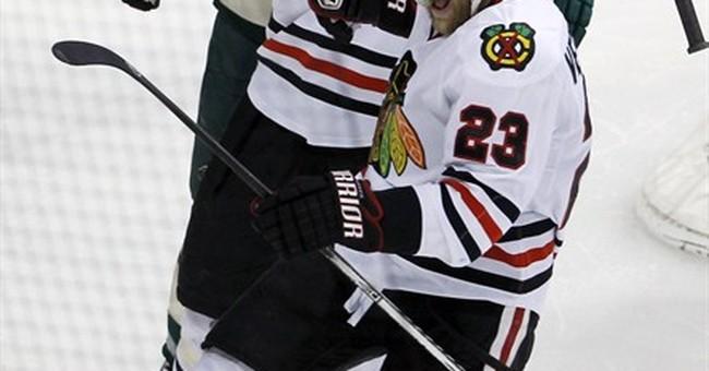 Kane, Blackhawks top Wild 2-1 in OT to advance