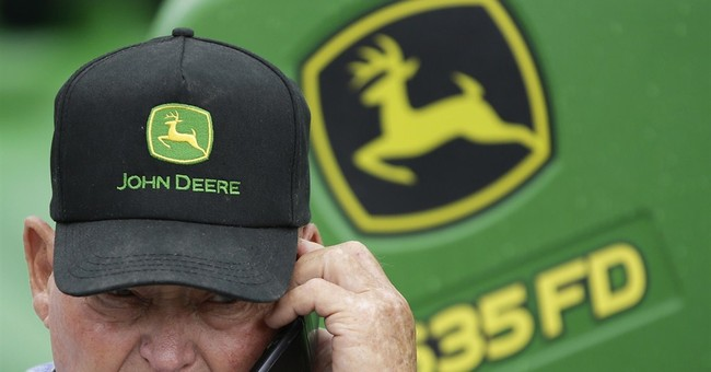 Deere 2Q profit falls, sales outlook cut