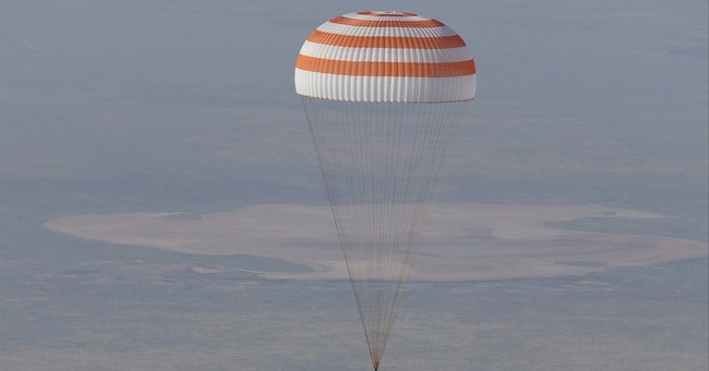 3 astronauts return to Earth