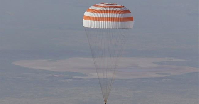 3 astronauts return to Earth