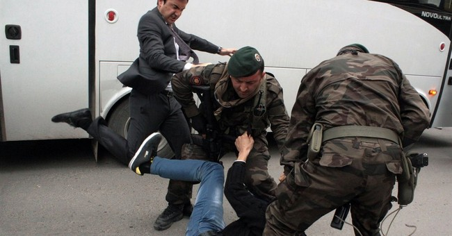 Turkey outraged as PM's aide kicks protester