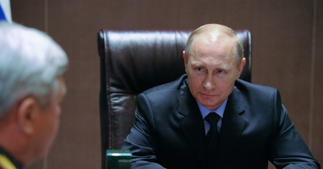 Putin says Ukraine must pay cash for gas in June