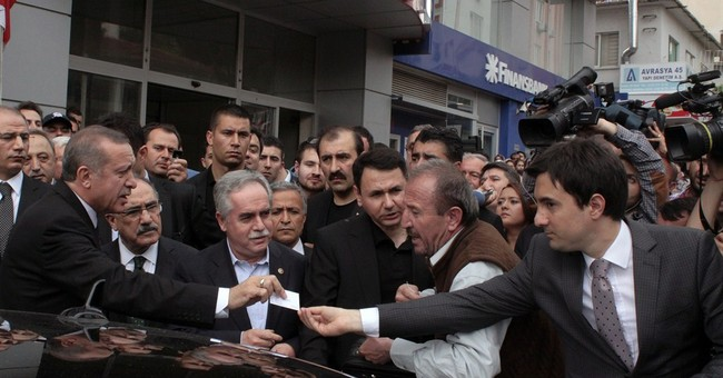 Turkish PM's ambitions seen unscathed by disaster