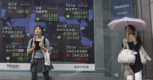 Asia stocks sunk by mixed reports on world economy