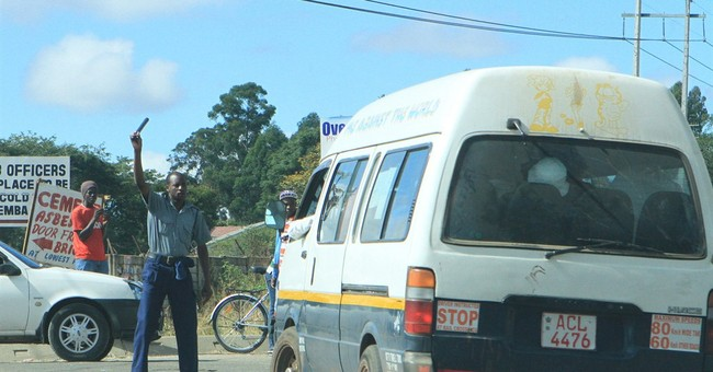 Zimbabwe police smash windows of illegal taxis
