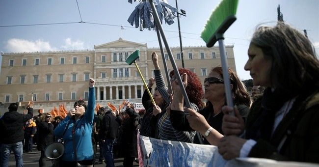 Symbol of Greece's protests, cleaners win in court