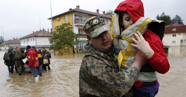 Thousands wait for evacuation from Balkan floods