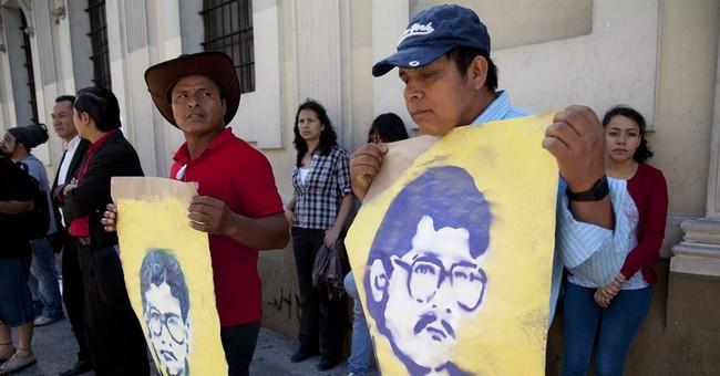 Dozens protest genocide denial in Guatemala