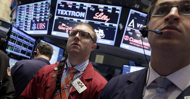 Stocks close slightly higher after day of wavering