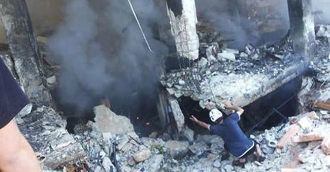 Rocket attack kills 13 in Syria's Aleppo