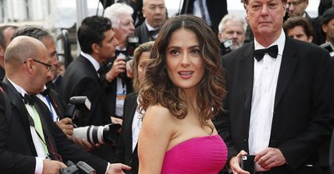CANNES WATCH: Hayek stands out with dress, message