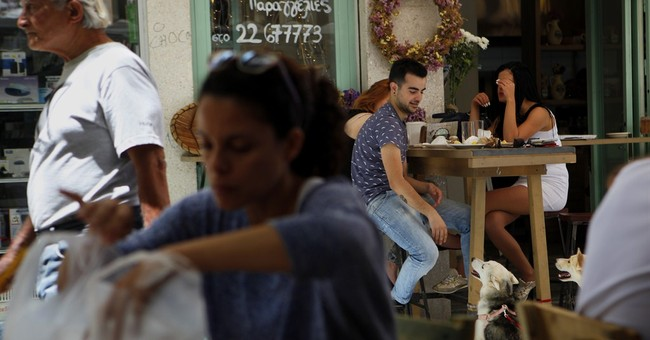 Cyprus says 4th bailout review is positive