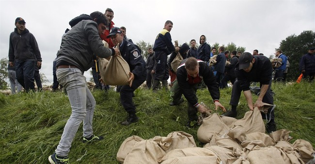 Thousands flee, 25 die in record Balkan floods