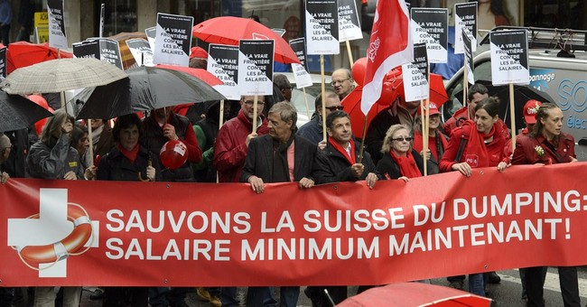 Swiss voters reject minimum wage, fighter jets
