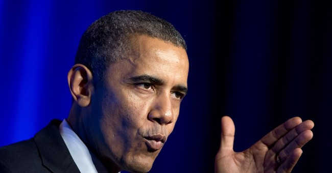 Obama supporting group cuts staffing, fundraising