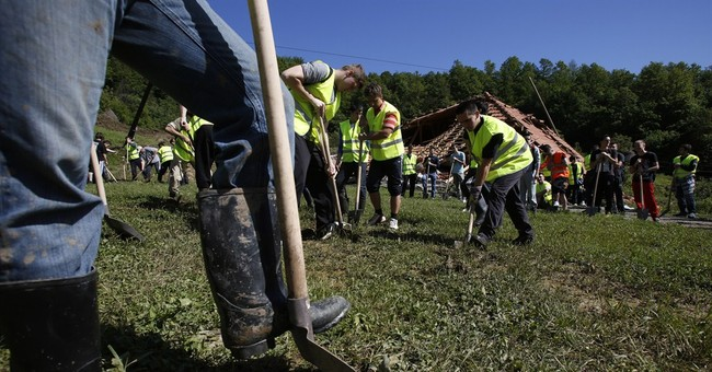 Floods threaten power plant, land mines in Balkans