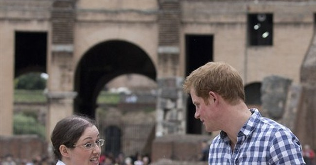 Prince Harry in Italy visits Colosseum, WWII site