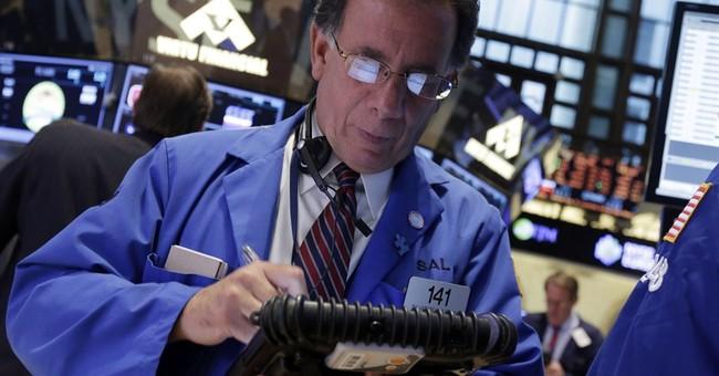 Stocks edge higher as investors consider deal news