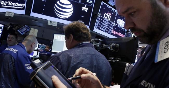 Stocks edge higher as investors asses deal news