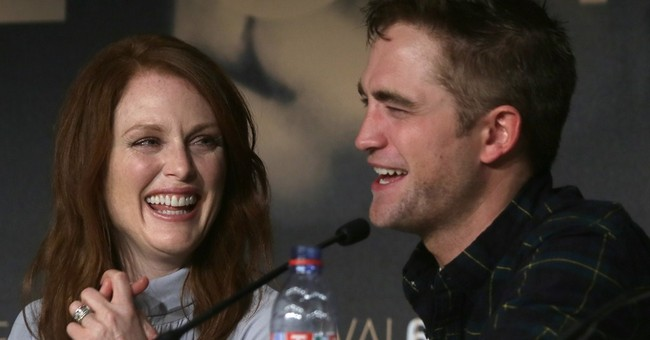 CANNES WATCH: R-Patz rates film romp with Moore