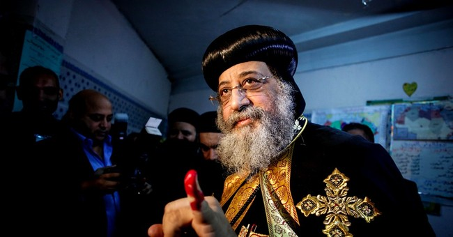 AP PHOTOS: Egyptians vote on draft constitution