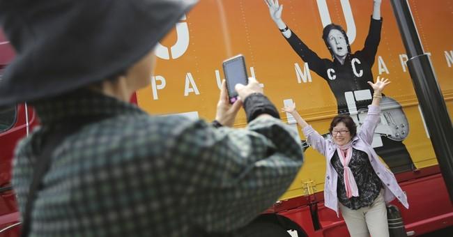 Paul McCartney treated in hospital for virus
