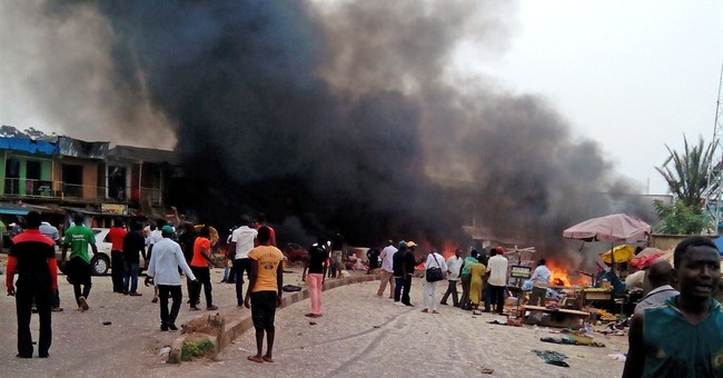 2 bomb blasts in Nigeria kill at least 118