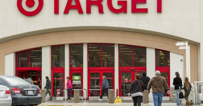 Target 1Q profit falls 16 pct as breach takes toll