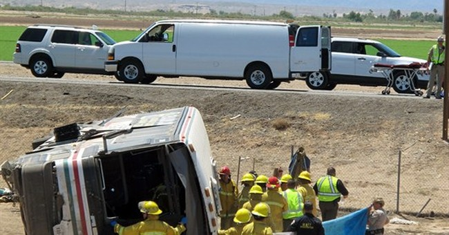 Bus strikes pipes on remote interstate, killing 4