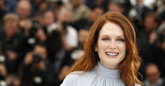 As a shallow actress, Moore a hit in Cannes