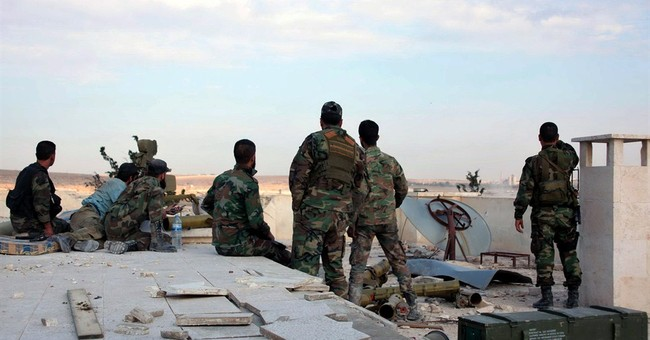 Syrian tanks roll into Aleppo prison grounds